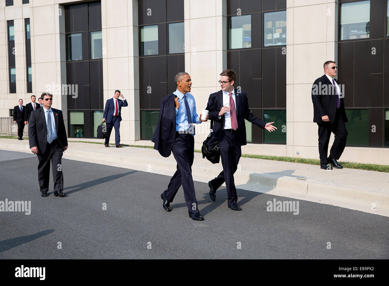 President Barack Obama Talks With White House Traveling Aide Bobby Schmuck As They Walk To The Walter Reed National Military Medical Center Landing Zone For