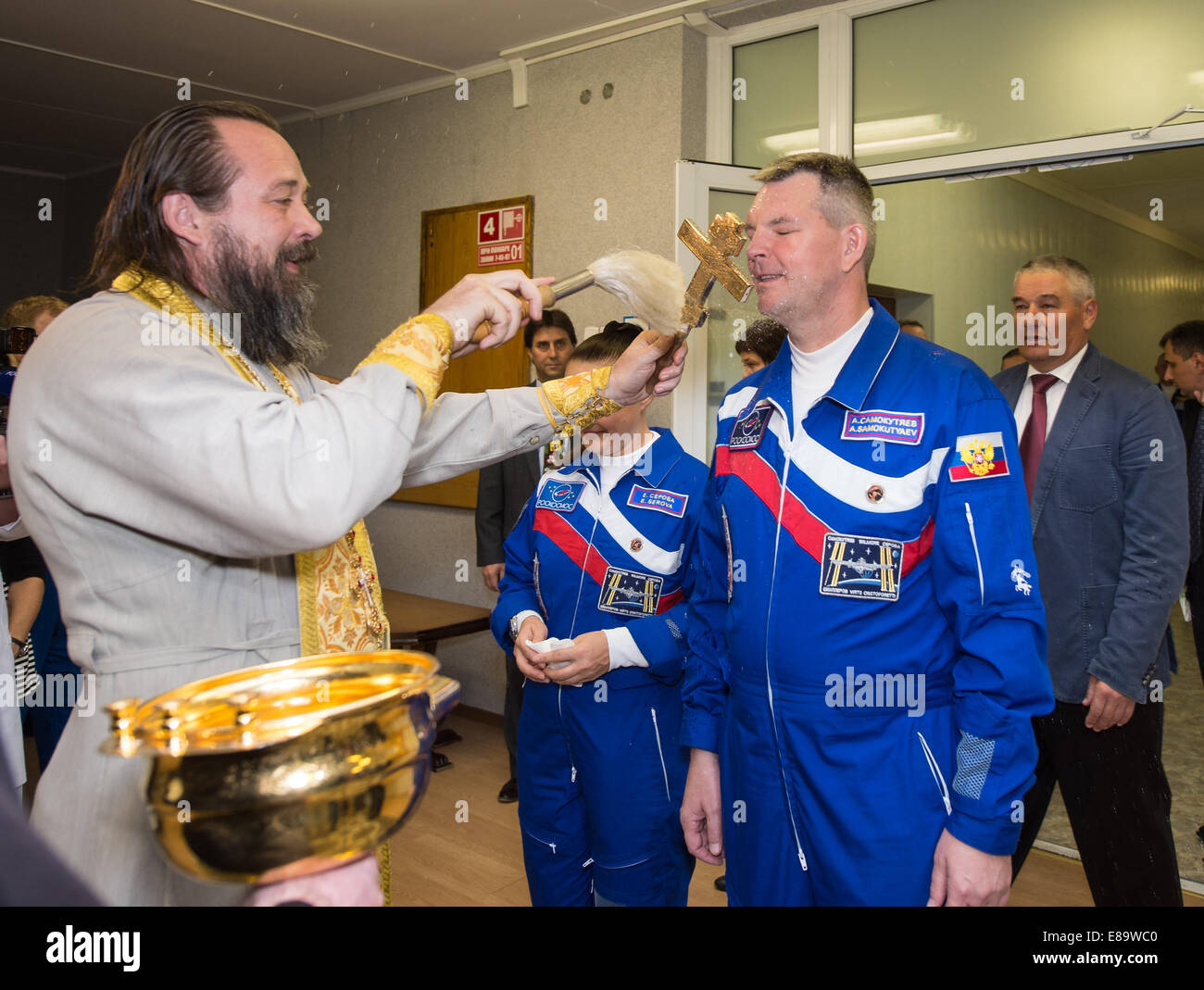 Expedition 41 Soyuz Commander Alexander Samokutyaev of the Russian Federal Space Agency (Roscosmos), right, receives - Stock Image