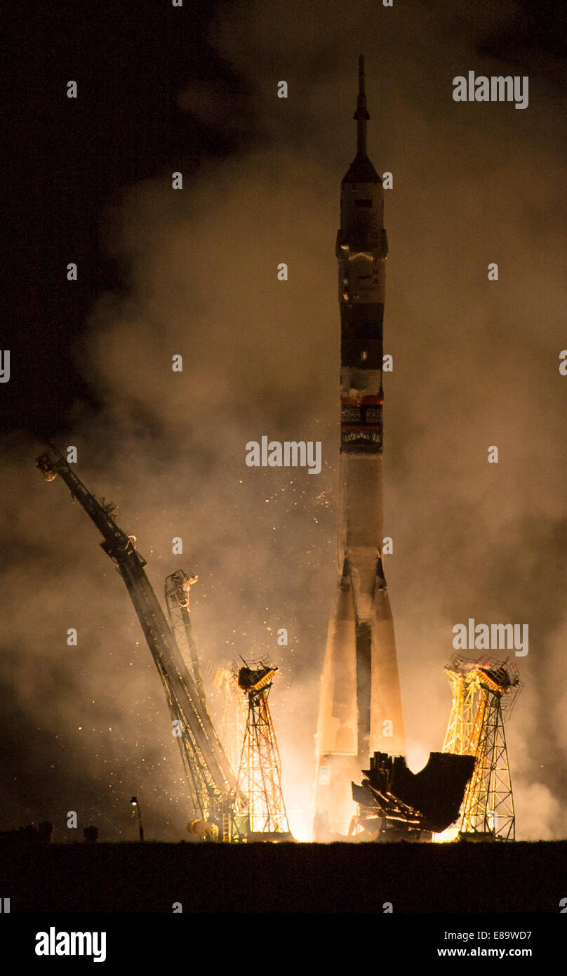 The Soyuz TMA-14M rocket is launched with Expedition 41 Soyuz Commander Alexander Samokutyaev of the Russian Federal - Stock Image
