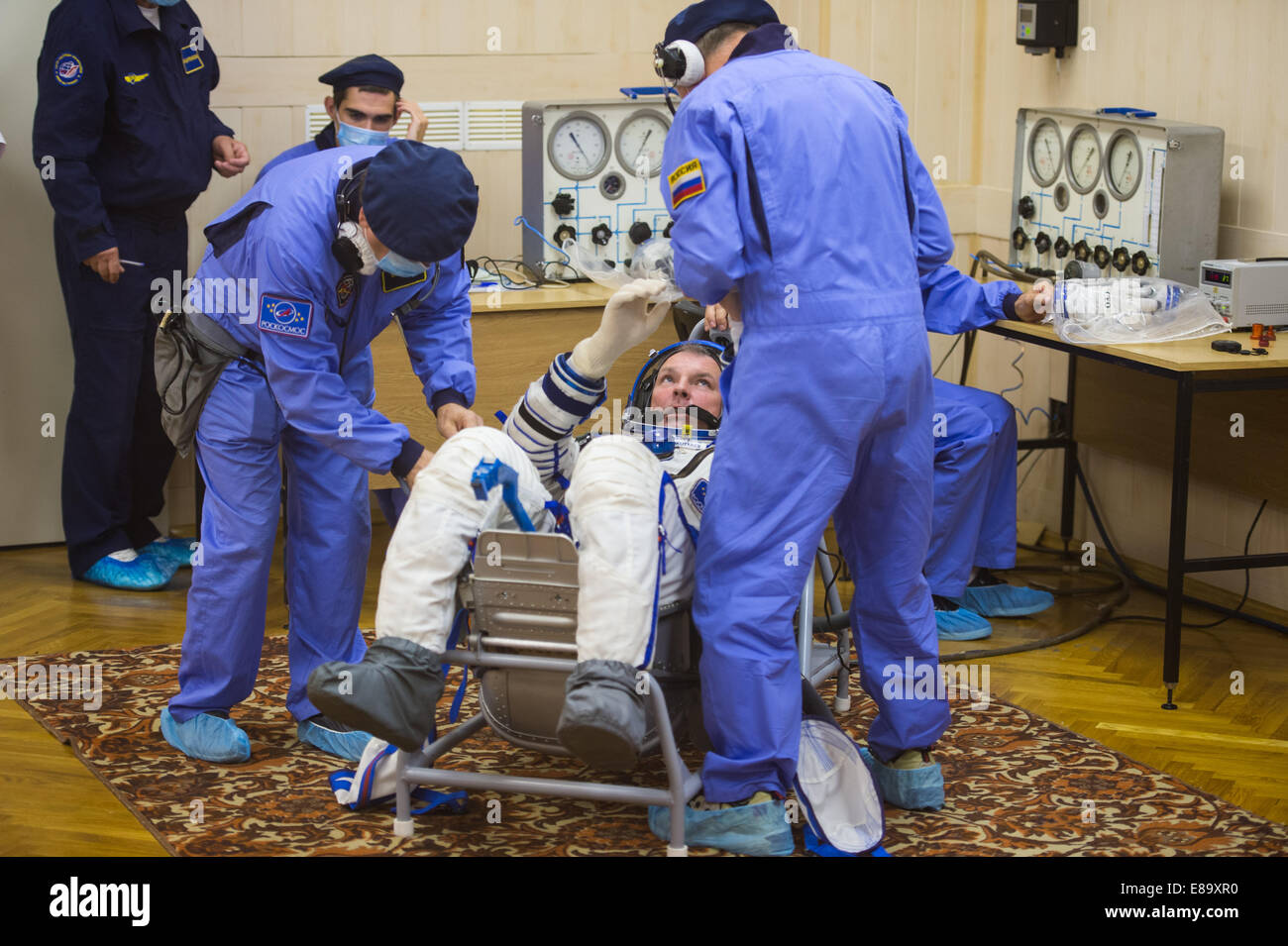 Expedition 41 Soyuz Commander Alexander Samokutyaev of the Russian Federal Space Agency (Roscosmos) has his Russian - Stock Image