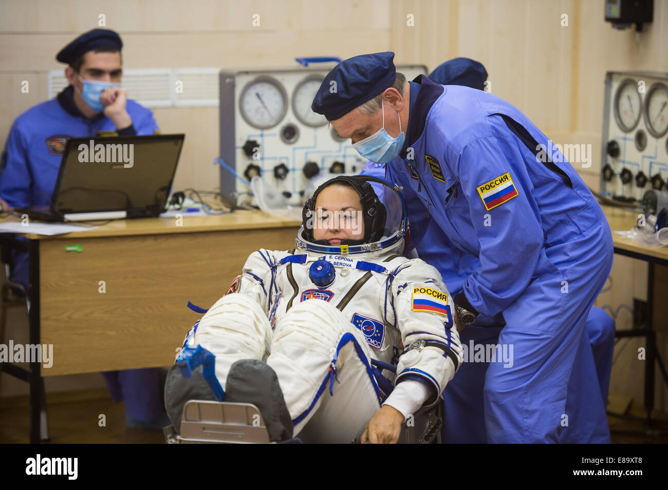 Expedition 41 Flight Engineer Elena Serova of the Russian Federal Space Agency (Roscosmos) has her Russian Sokol - Stock Image