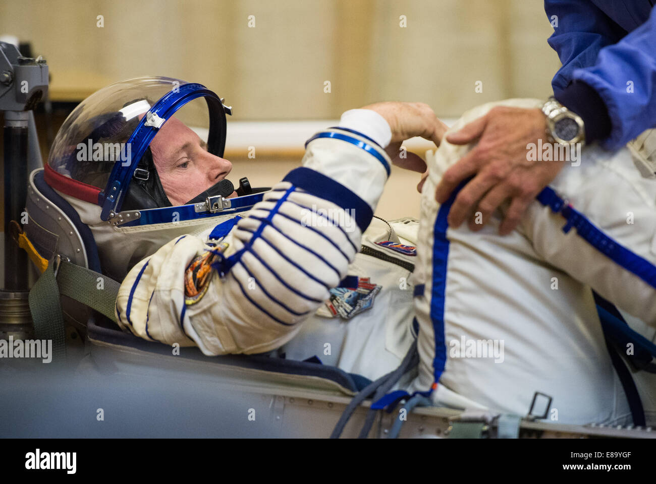 Expedition 41 Flight Engineer Barry Wilmore of NASA prepares to have his Russian Sokol suit pressure checked in - Stock Image
