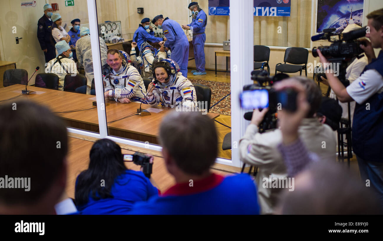 Expedition 41 Flight Engineer Elena Serova of the Russian Federal Space Agency (Roscosmos), right, and Soyuz Commadner - Stock Image