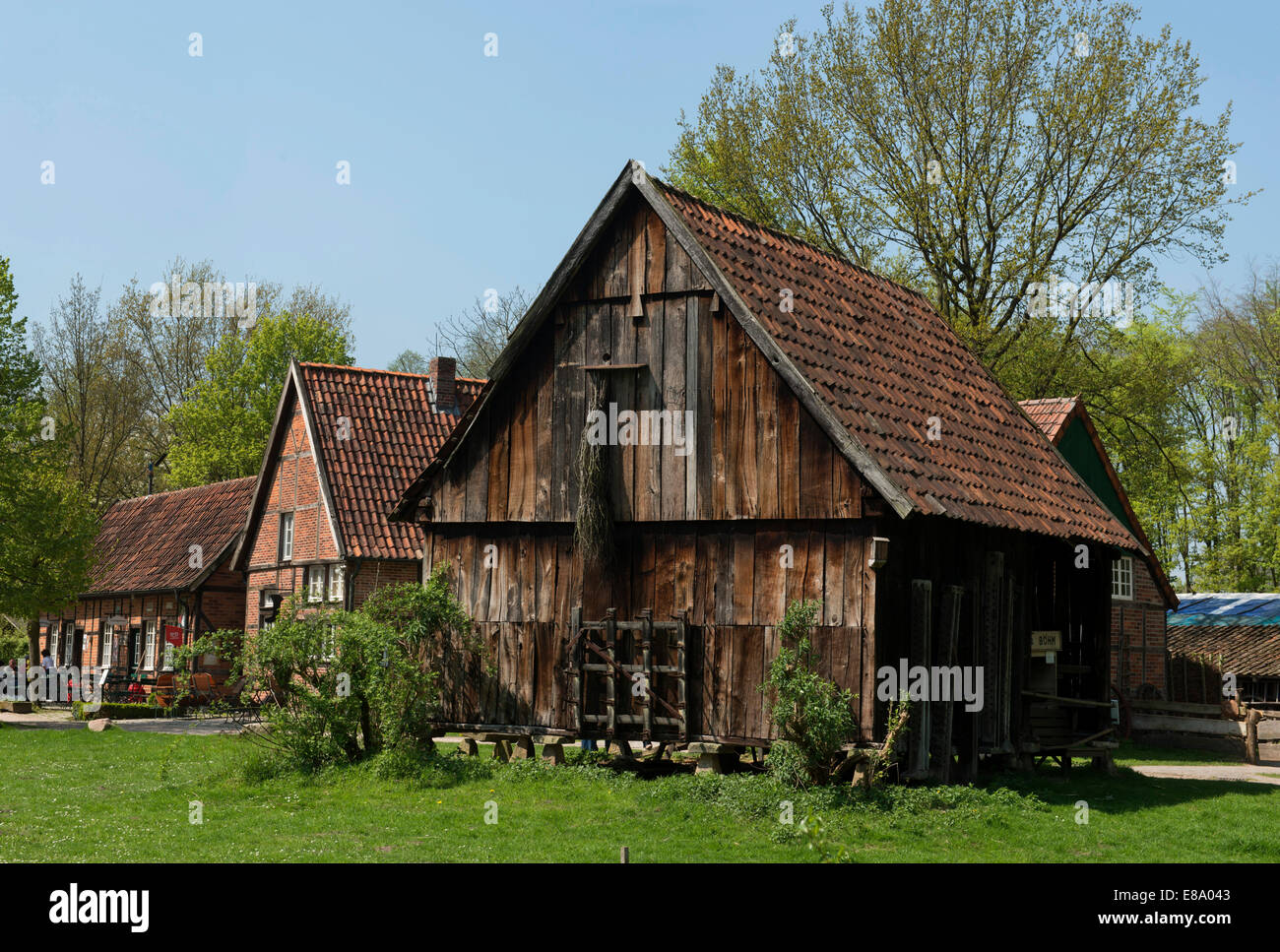 Barn on pillars with stone slabs to protect the grain from mice, Mühlenhof-Freilichtmuseum Münster open - Stock Image