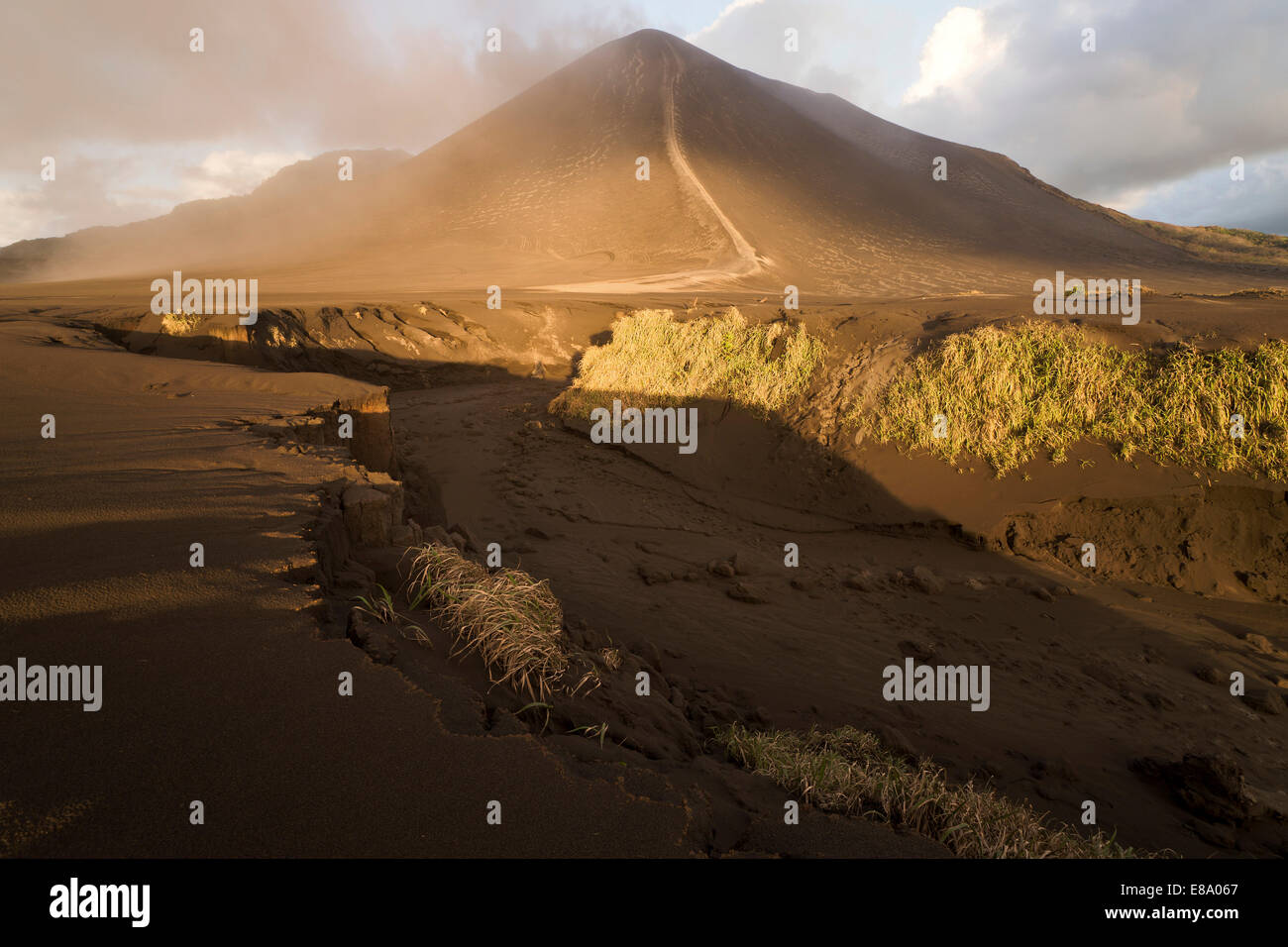 Dry riverbed in front of Ash Plain, Mount Yasur volcano, Tanna Island, Vanuatu Stock Photo