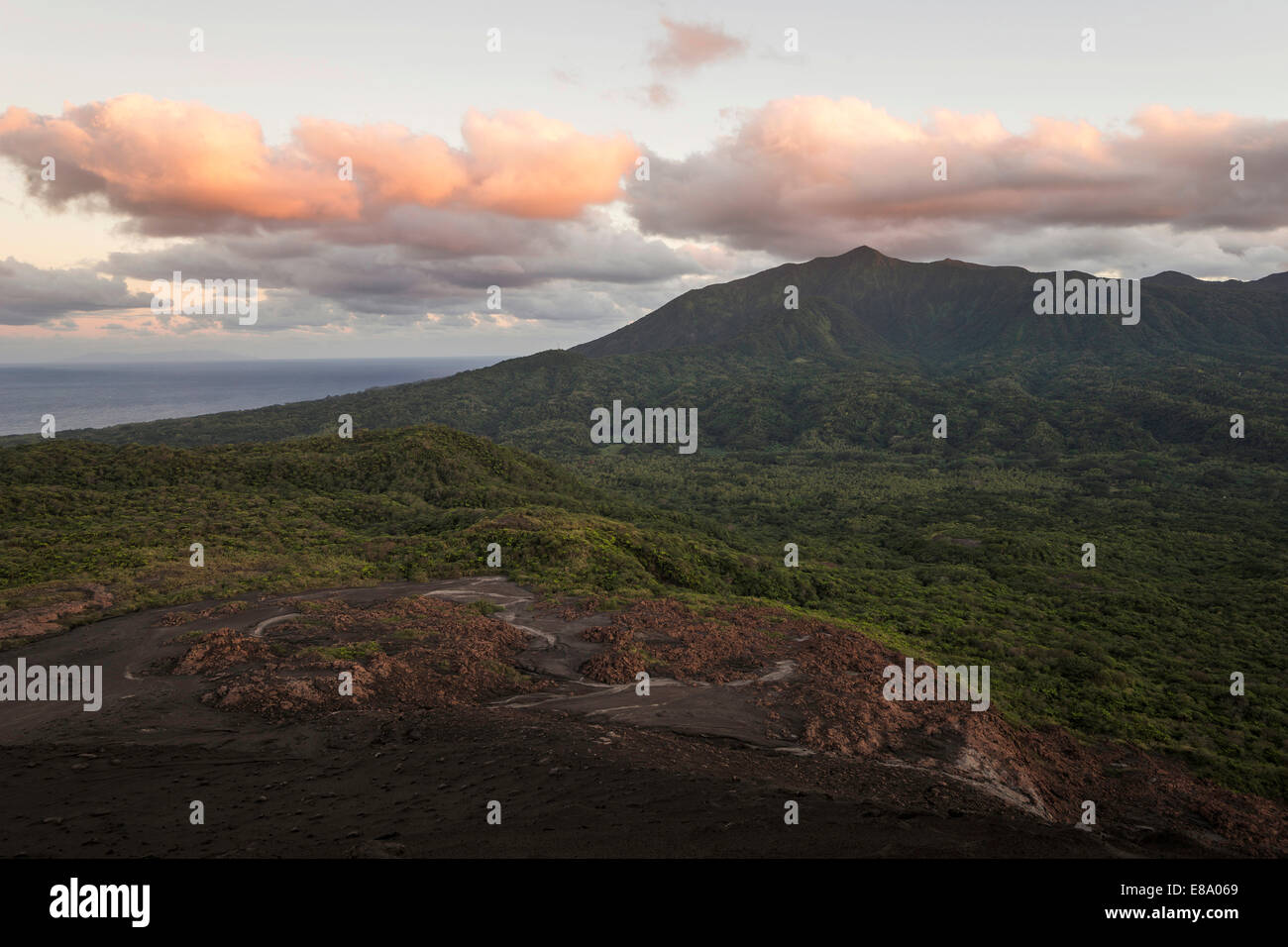 View from the crater of Mount Yasur volcano onto the sea in the morning light, Tanna Island, Vanuatu - Stock Image