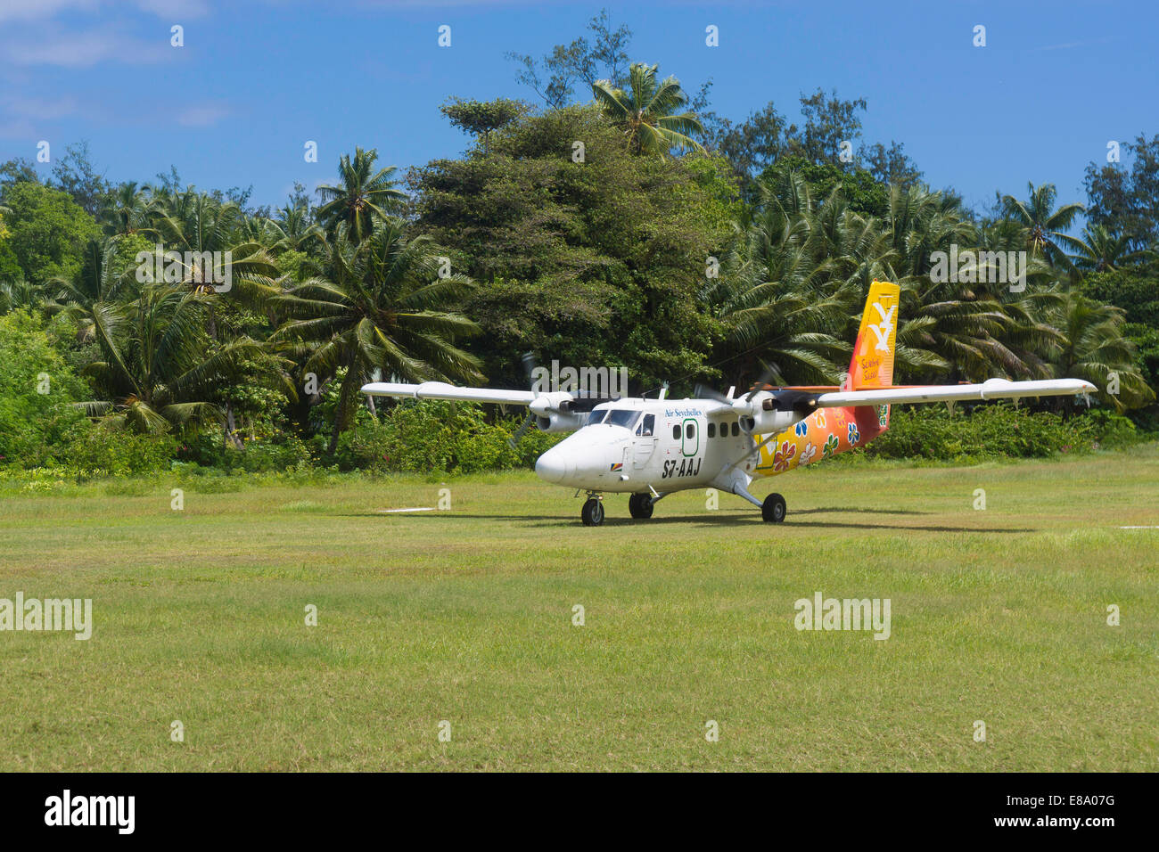 Aircraft 'Twin Otter' of the AIR SEYCHELLES airline at the airport of Denis Island, Seychelles - Stock Image