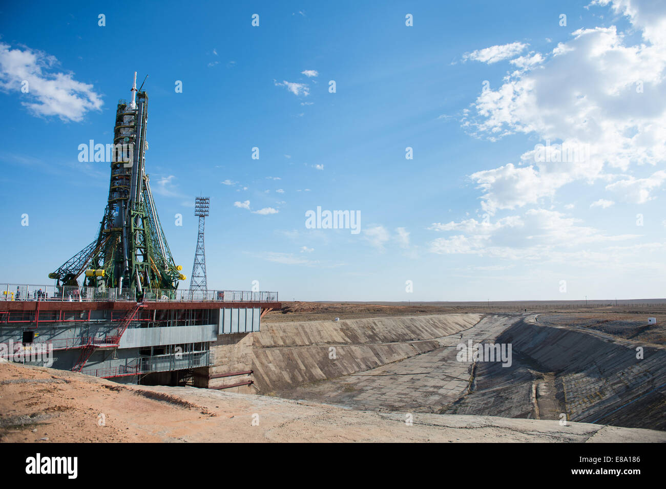 The Soyuz TMA-14M spacecraft is seen after the gantry arms closed securing the rocket in the veritcal position at - Stock Image