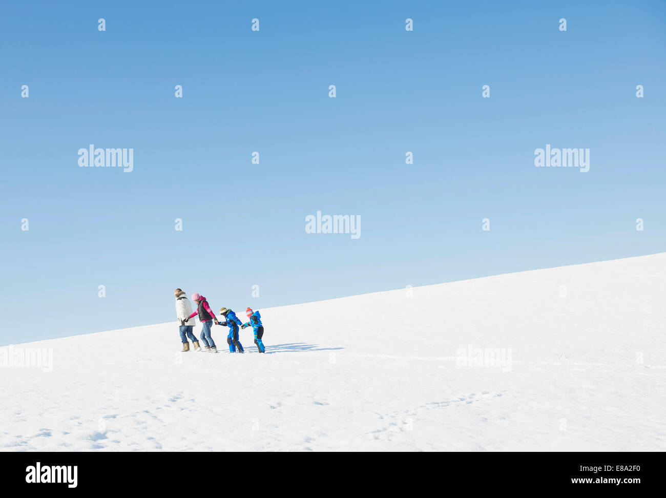 Family walking in snow, Bavaria, Germany - Stock Image