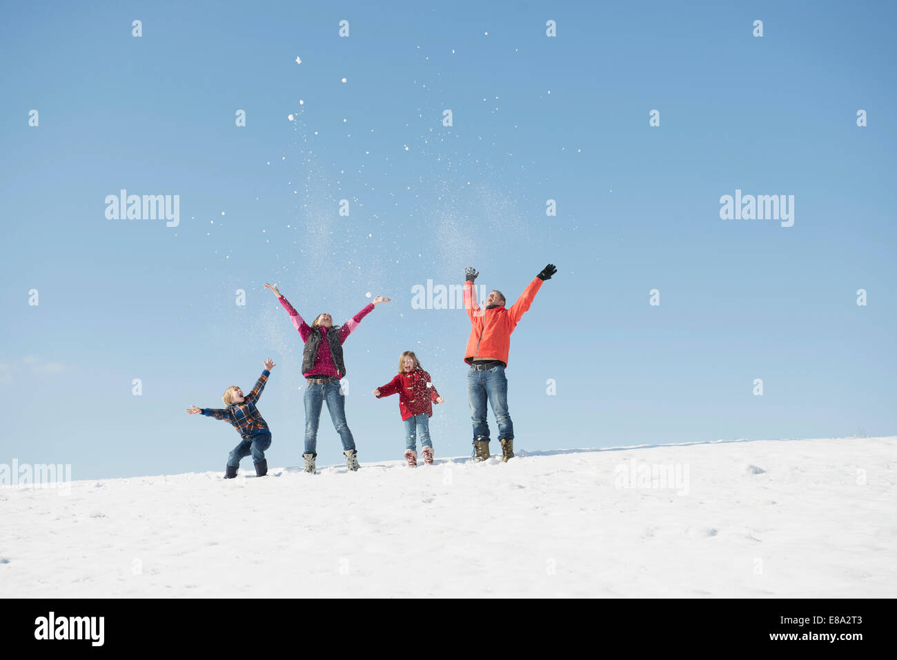 Family playing with snow in winter, Bavaria, Germany Stock Photo
