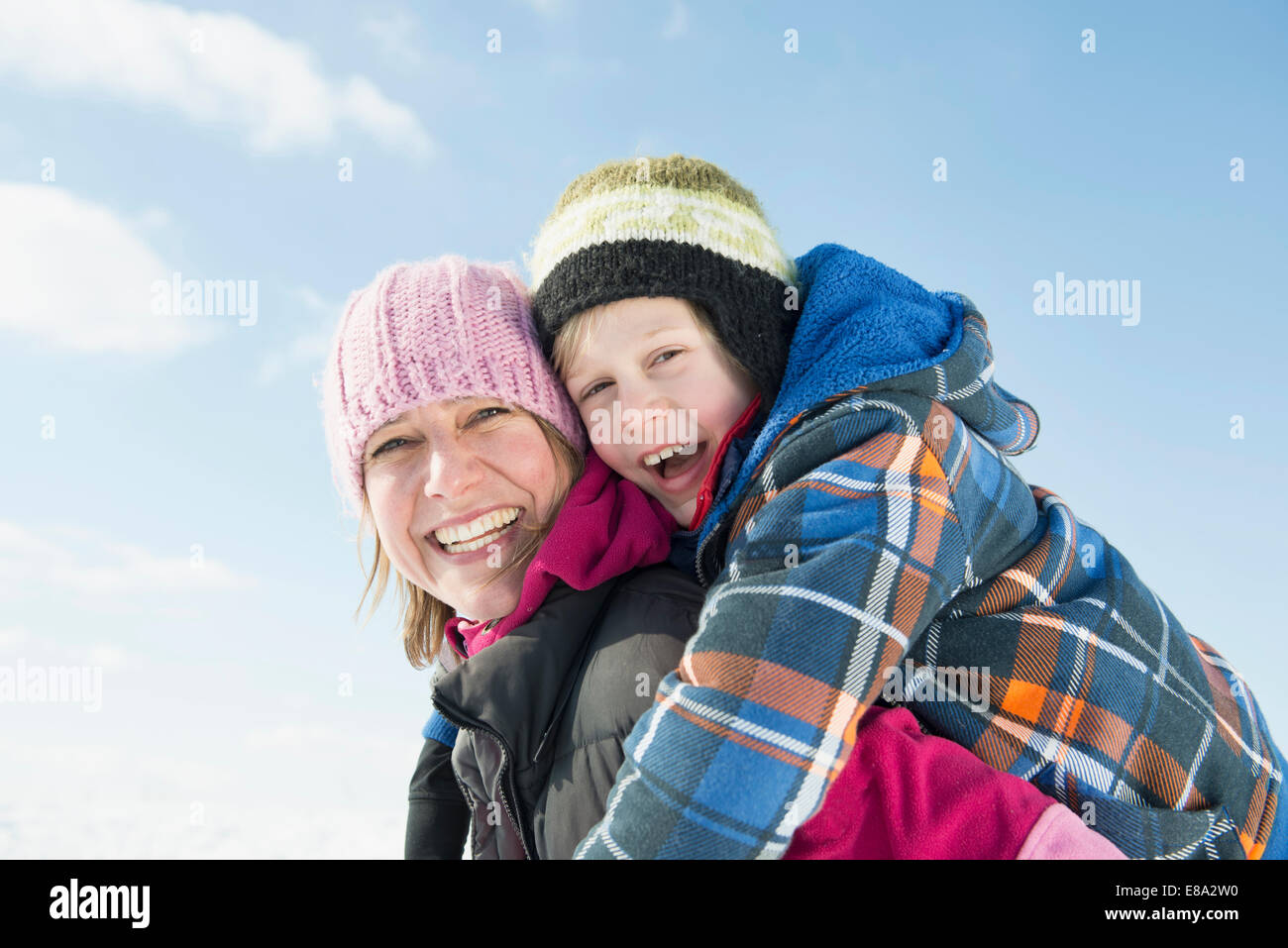 Mother giving piggy back ride to son, smiling, portrait, Bavaria, Germany - Stock Image