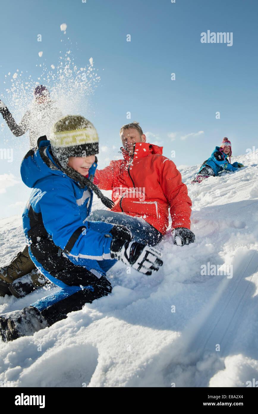 Family having snowball fight, Bavaria, Germany - Stock Image
