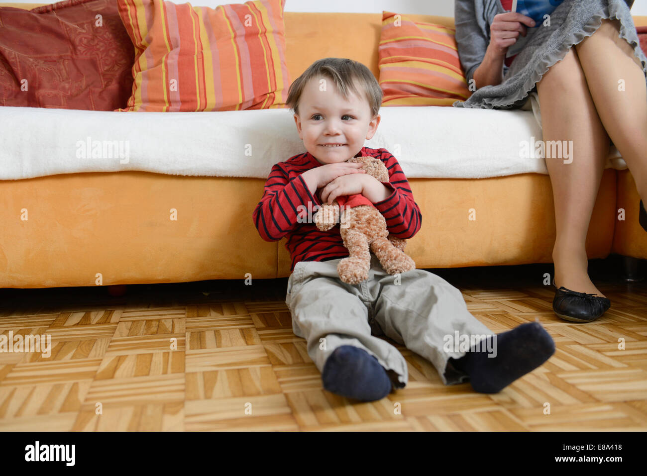 Mature and boy on the floor