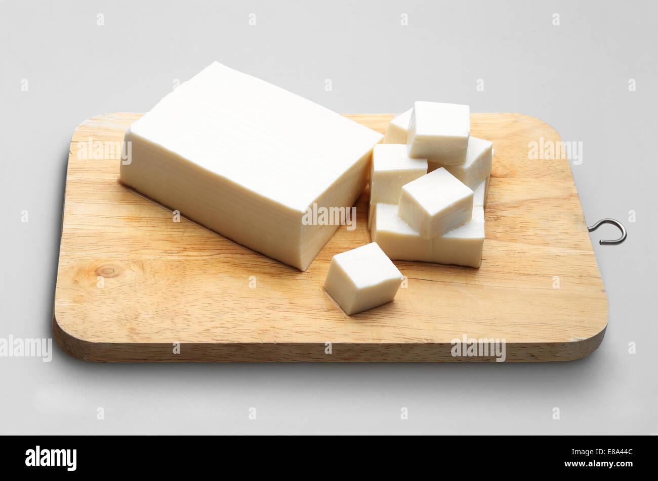 Tofu on block sliced - Stock Image