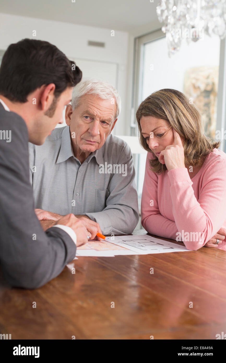 Consultant advising couple at home - Stock Image