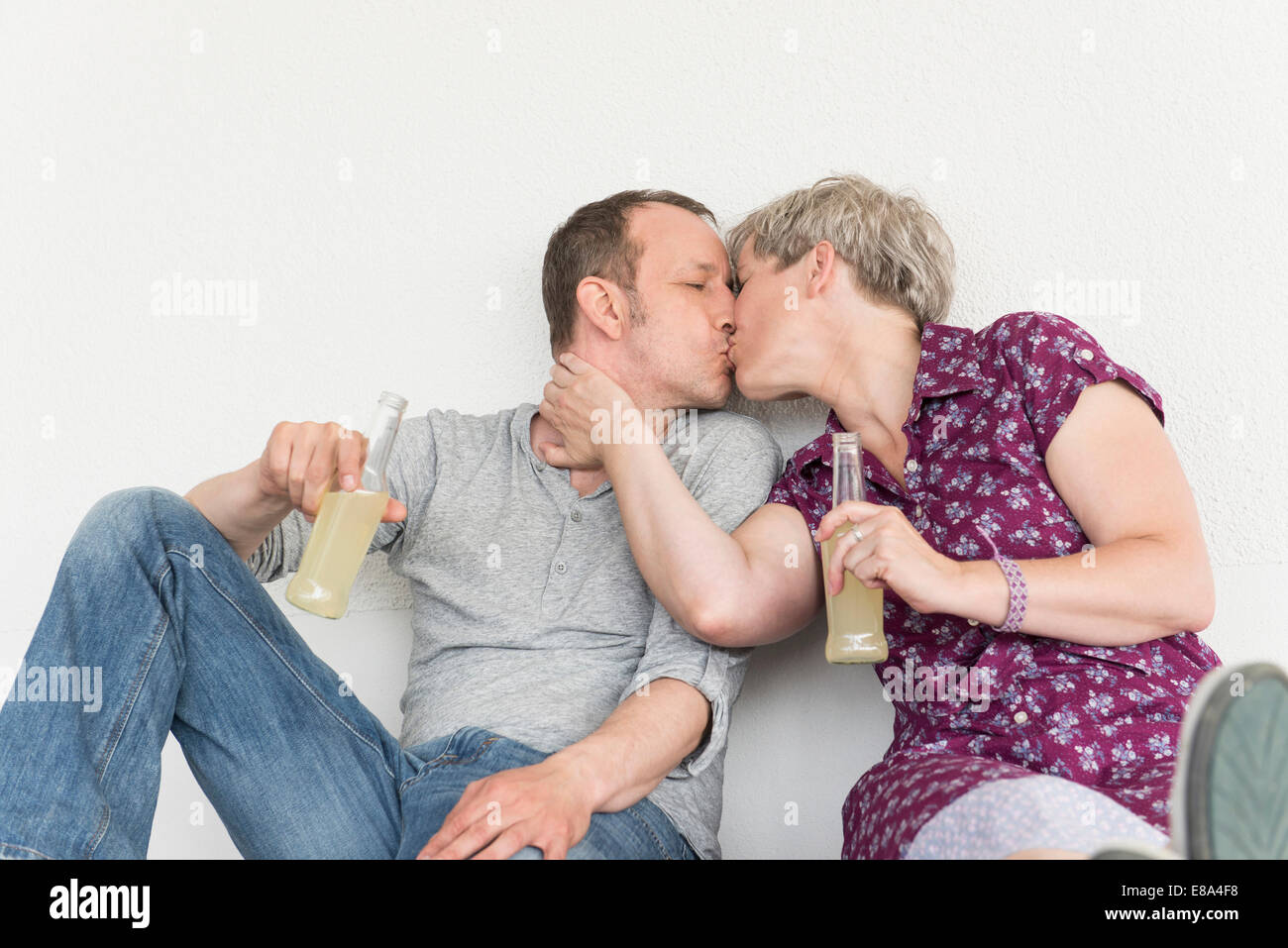 Mature women kissing each other