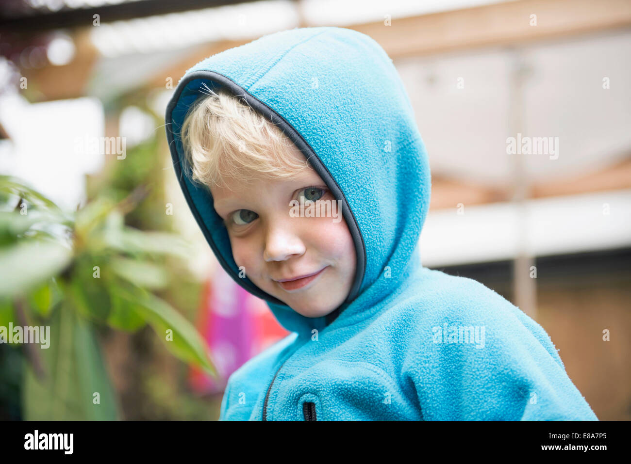 portrait young blonde boy with hoody jumper - Stock Image