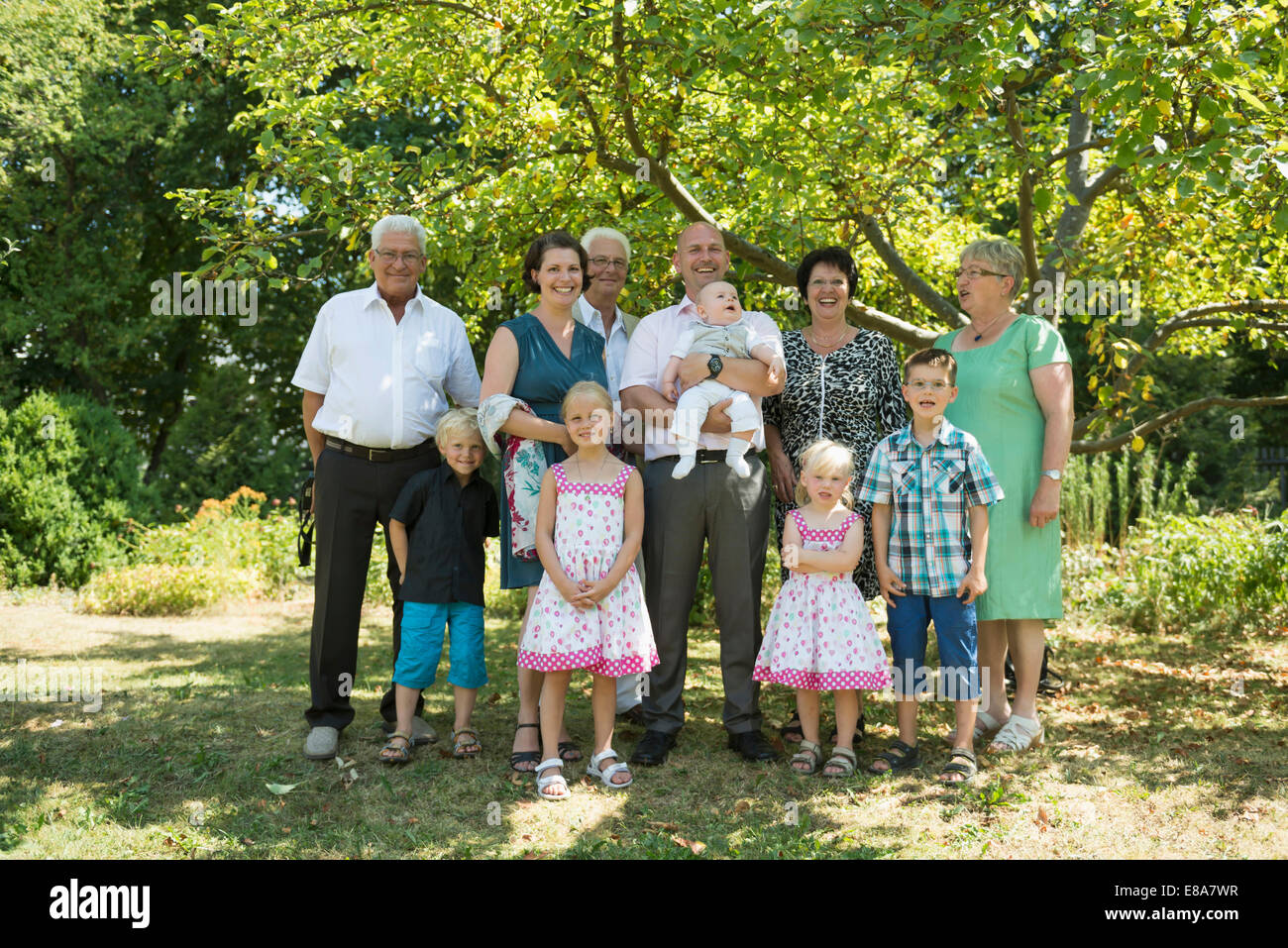 Family portrait of multi-generation family - Stock Image