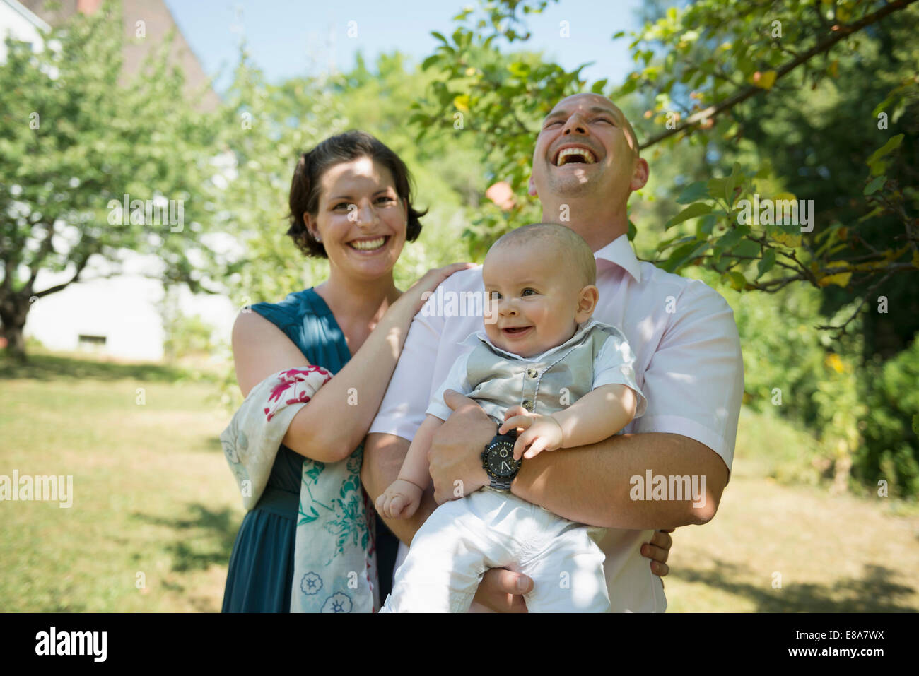 Laughing parents with smiling baby - Stock Image