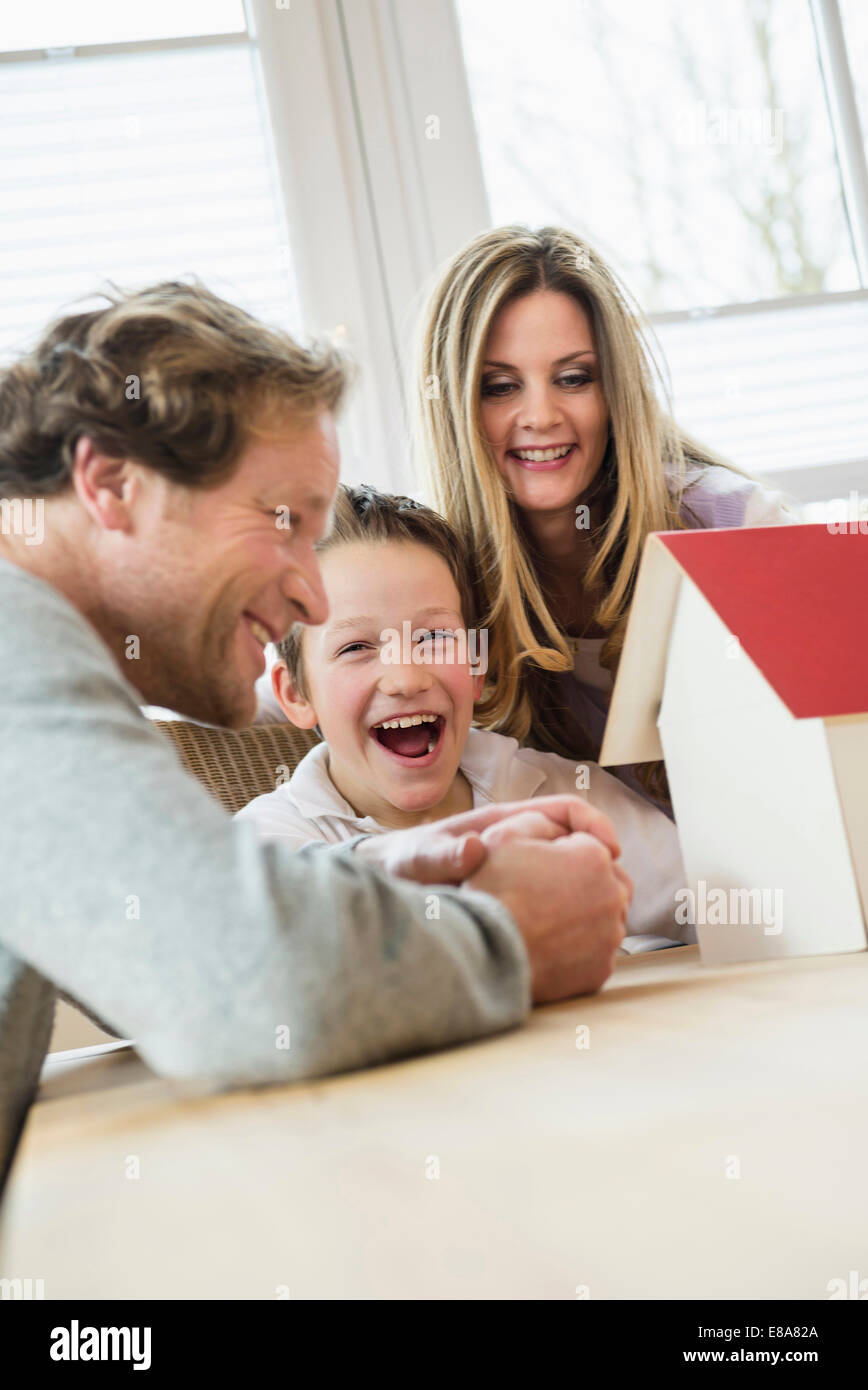 Family with architectural model at table - Stock Image