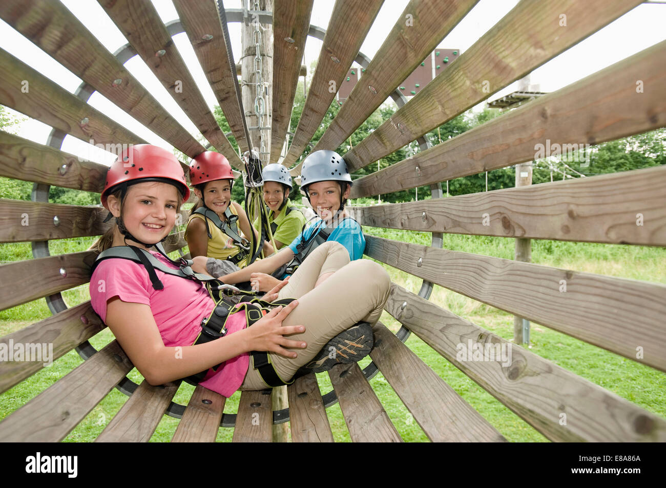 Portrait of girls and boys relaxing, smiling - Stock Image