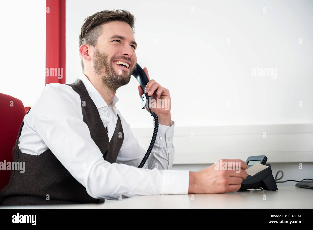 Man telephone conversation laughing office - Stock Image