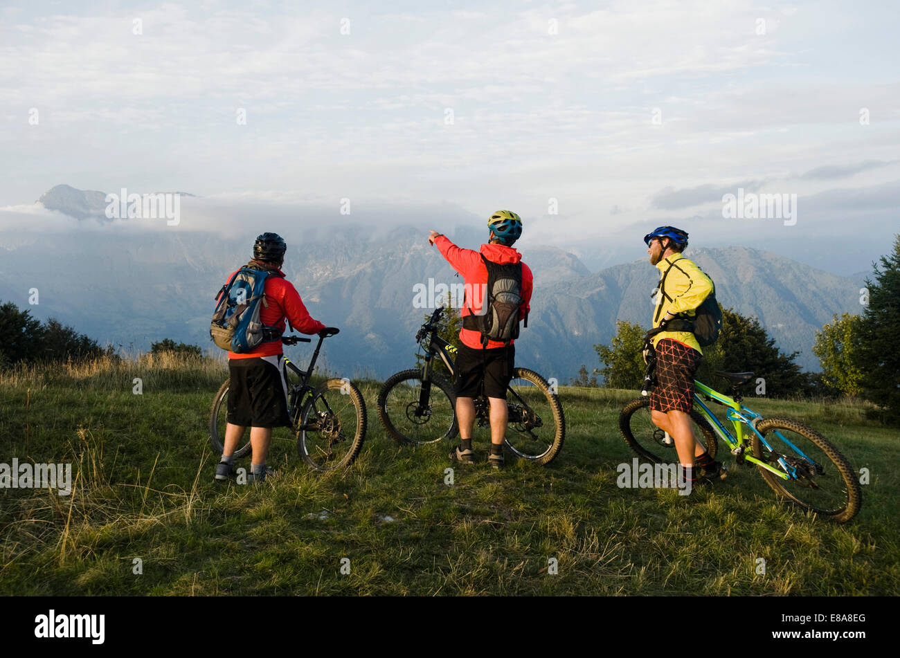 three mountain bikers looking at view, Kolovrat, Istria, Slovenia - Stock Image
