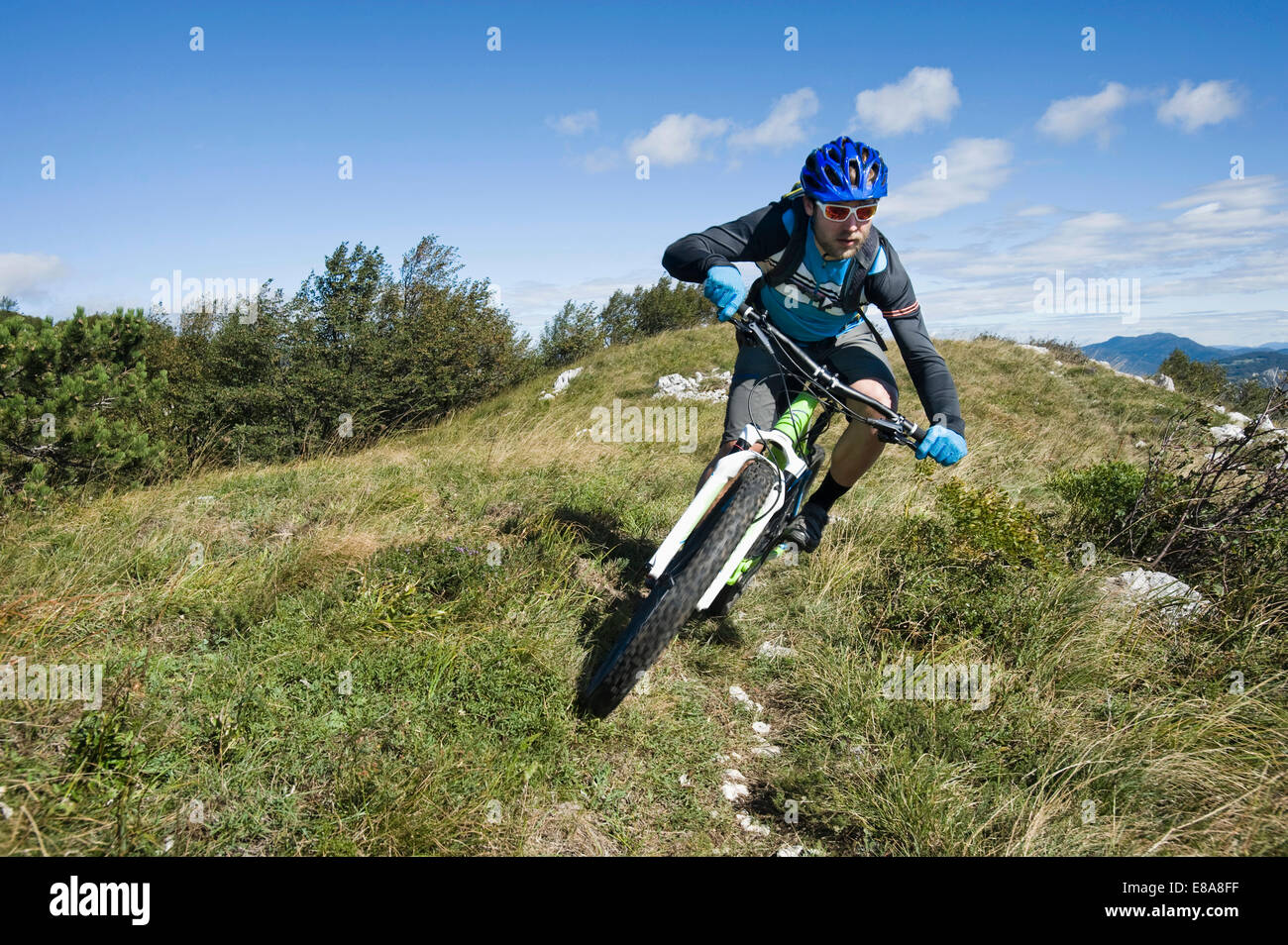 mountain biker on the way downhill, Vipava valley, Istria, Slovenia - Stock Image