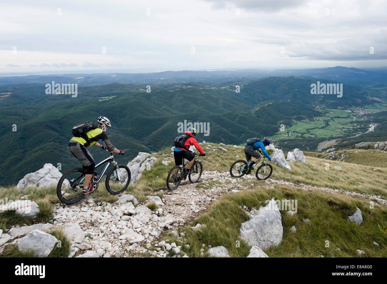 three mountain bikers looking at view, Vipava valley, Istria, Nanos, Slovenia Stock Photo