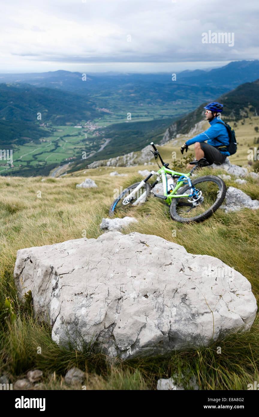 mountain biker having a rest, Vipava valley, Istria, Nanos, Slovenia - Stock Image