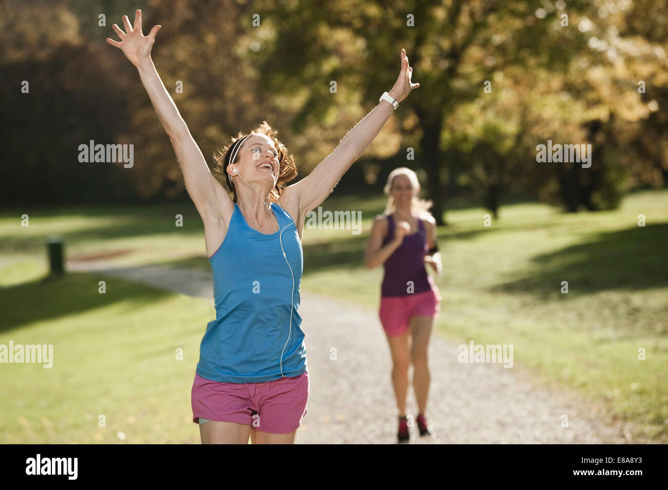 Women jogging in park, Woerthsee, Bavaria, Germany - Stock Image