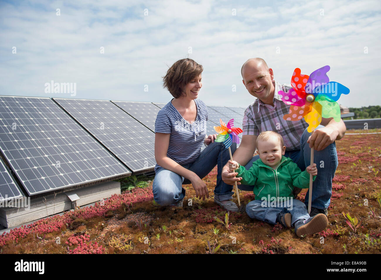 Young family wind solar power environmental issues - Stock Image