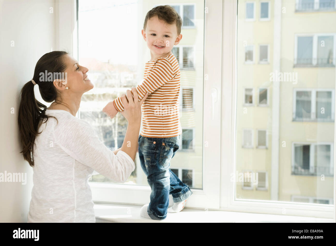 Mother and son smiling - Stock Image