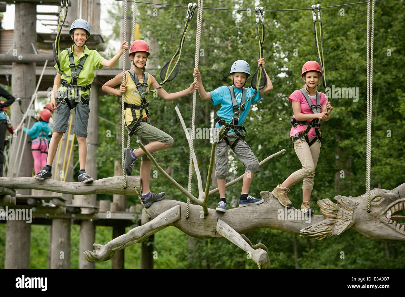 Childrens climbing on crag - Stock Image
