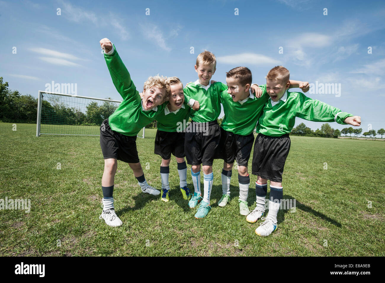 Young football team soccer shouting happy - Stock Image