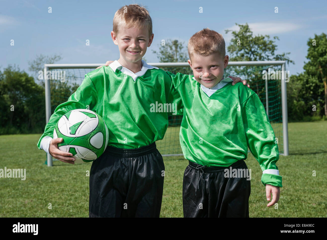 Two boys young soccer players posing portrait - Stock Image