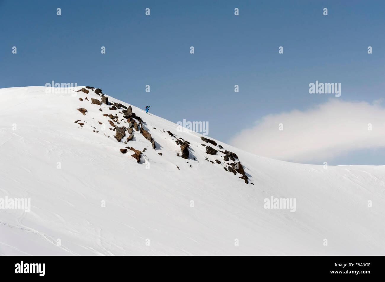 Man skiing downhill steep ski slope Alps - Stock Image