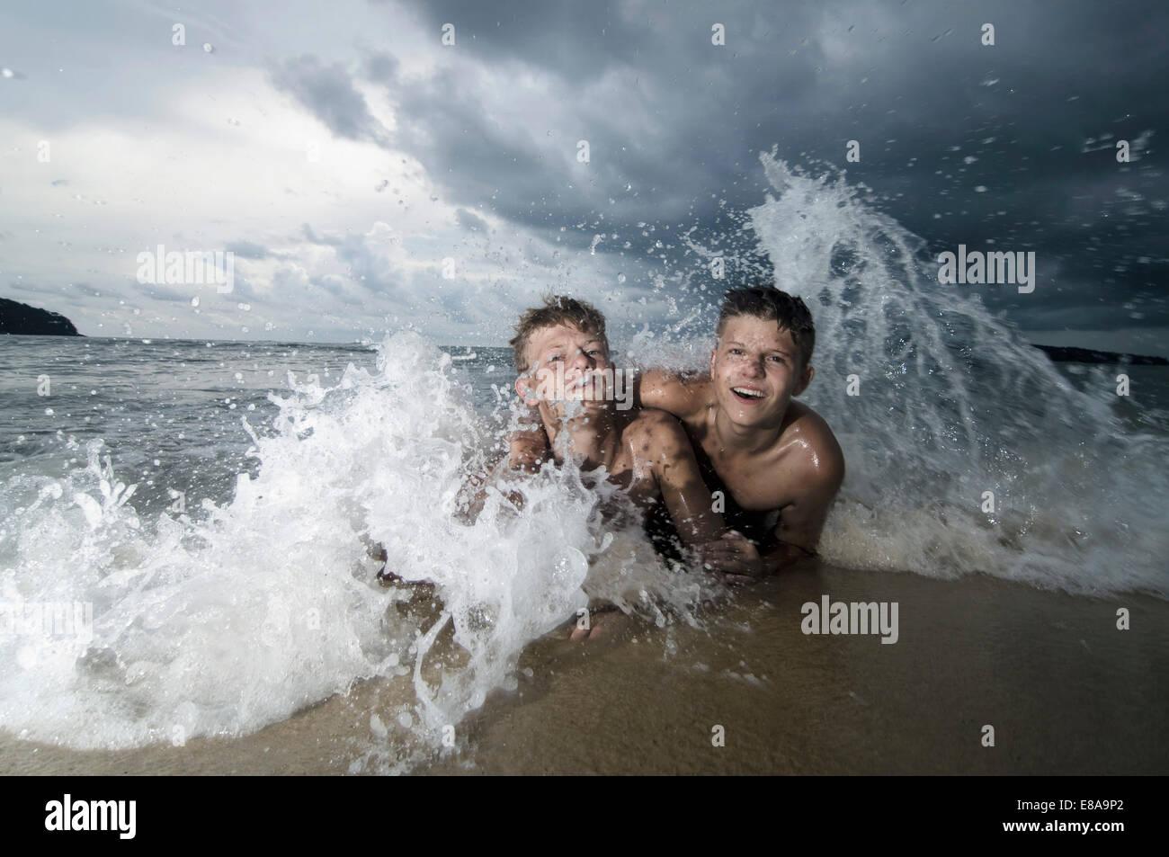 two boys having fun in ocean, Lankawi, Malaysia - Stock Image
