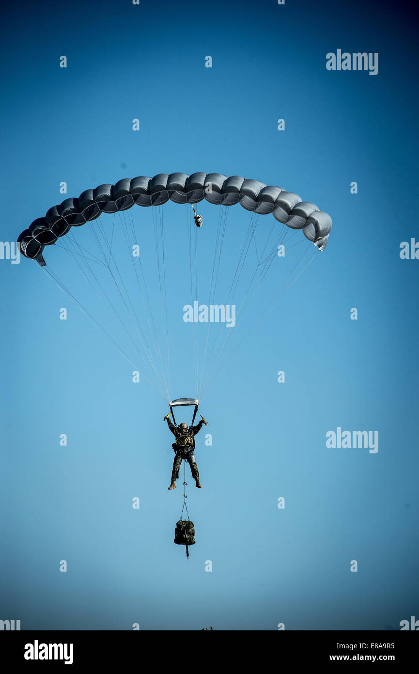 A Spanish army paratrooper parachutes into a troop review ceremony during a visit by U.S. Army Gen. Raymond T. Odierno, - Stock Image