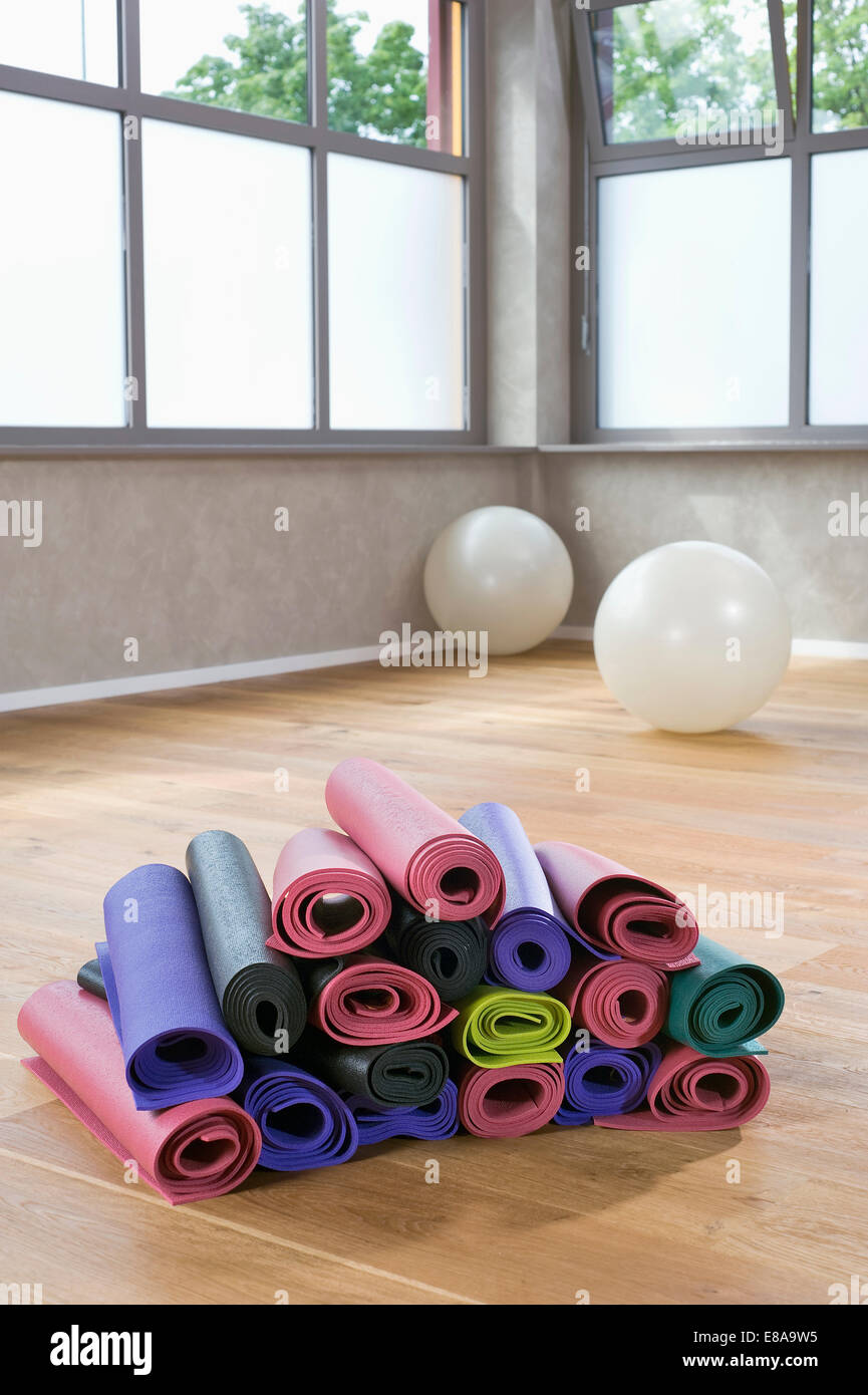 Pile of colorful Yoga mats in Yoga Studio - Stock Image