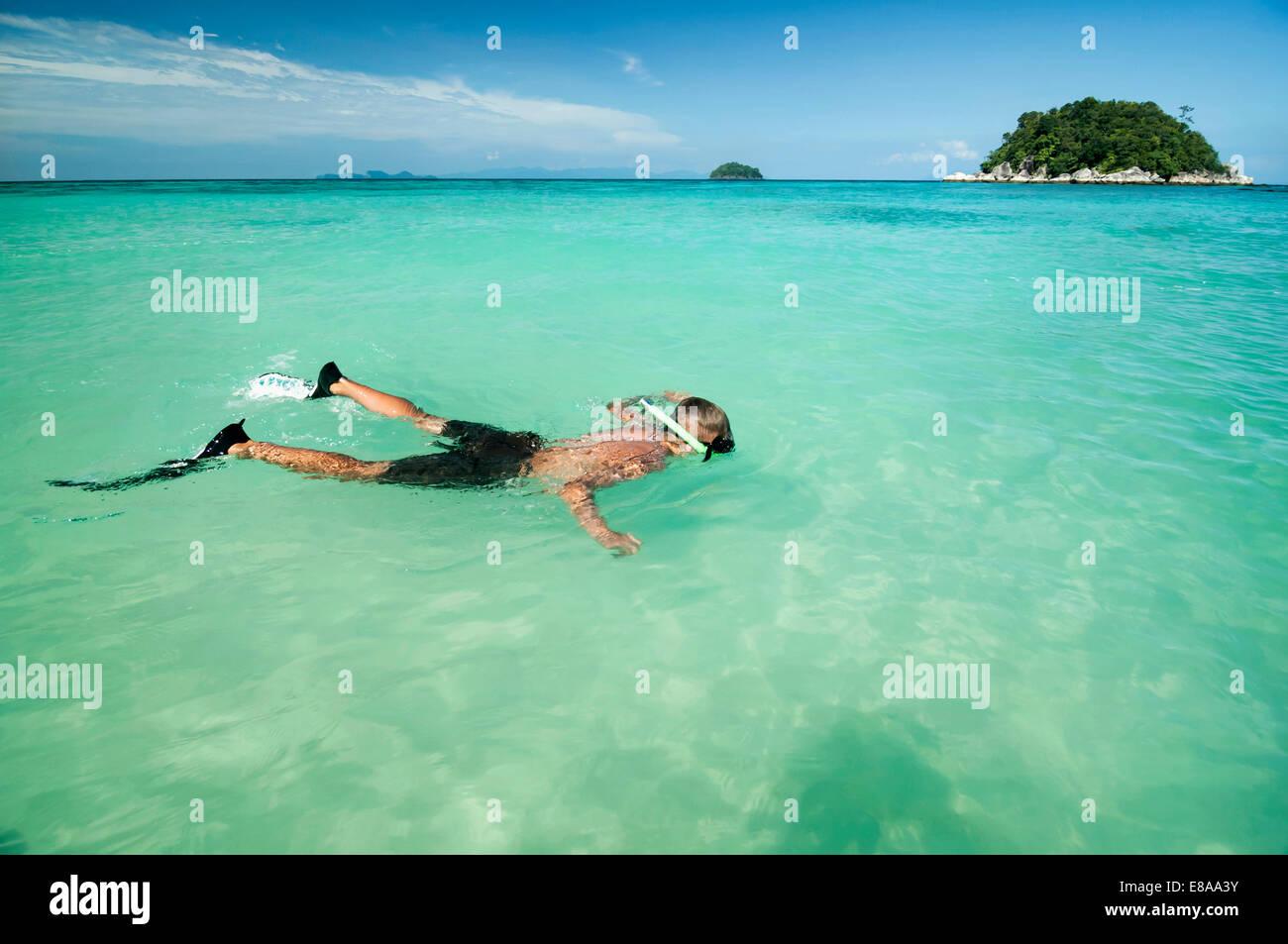 teenage boy snorkeling, Koh Lipe, Thailand - Stock Image