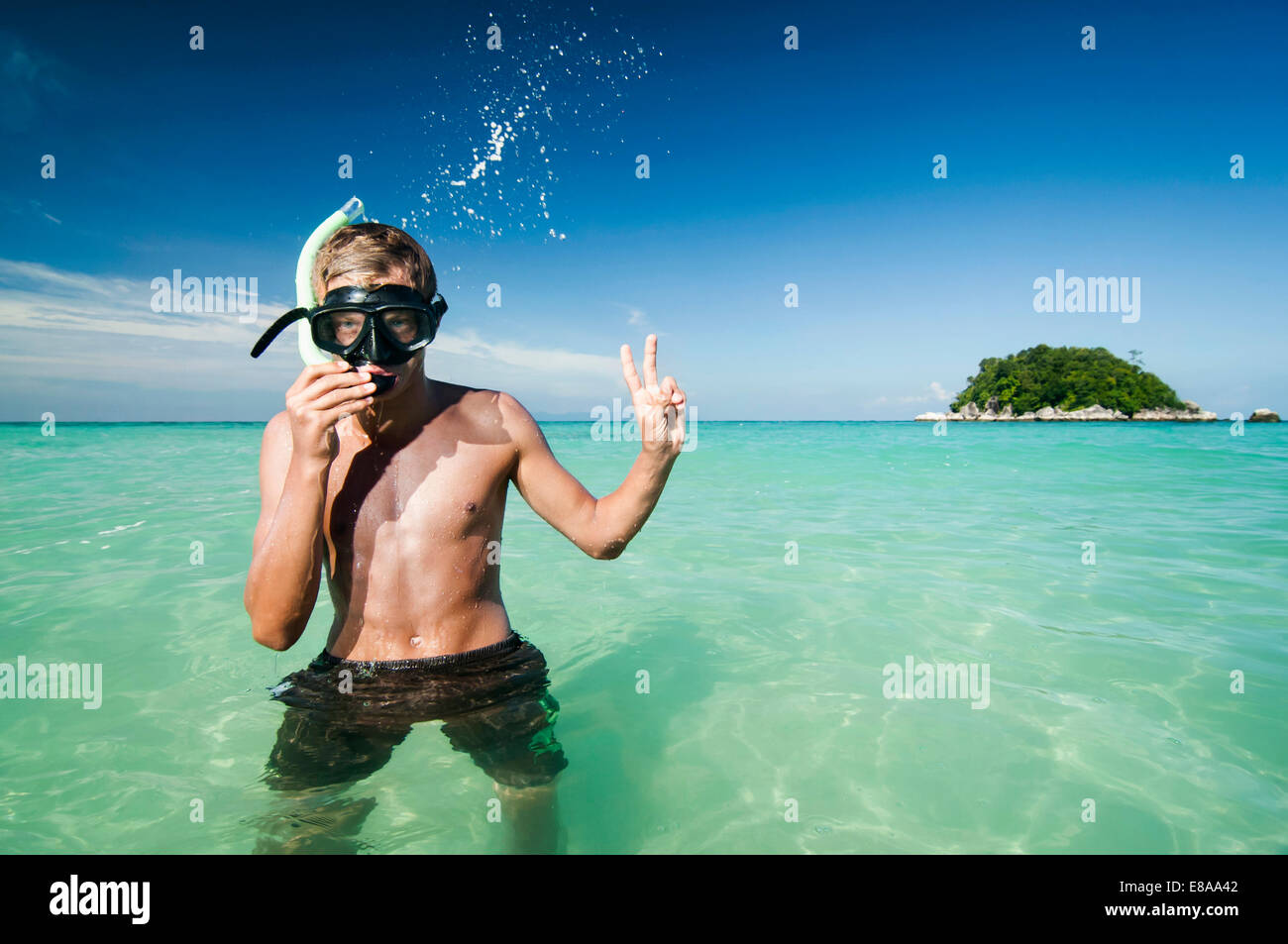 teenage boy with snorkeling equipment showing victory-sign, Koh Lipe, Thailand - Stock Image