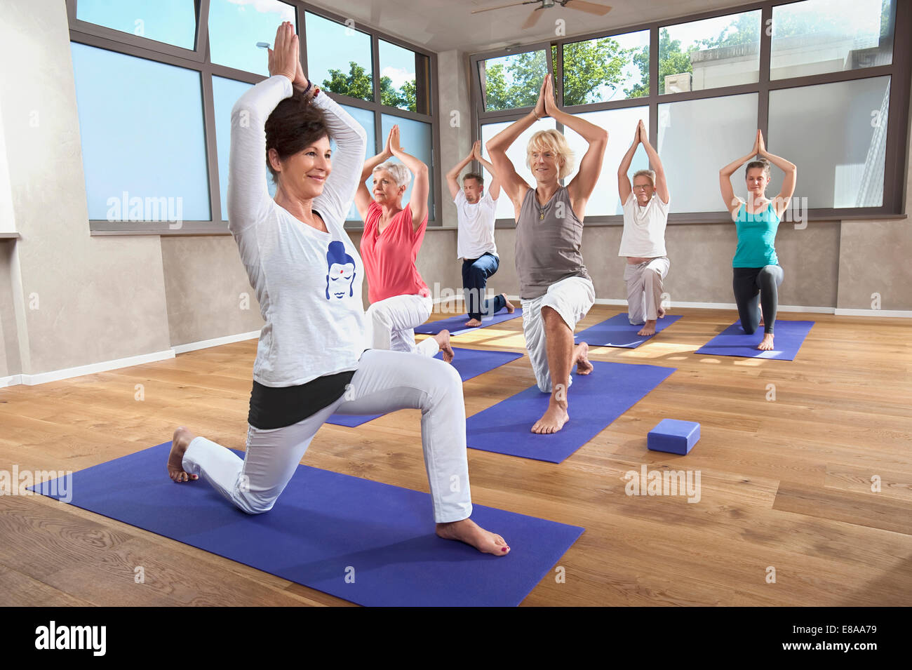 Yoga class female instructor senior group Stock Photo