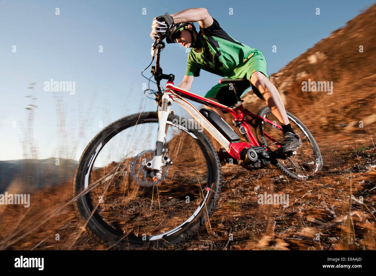 Man biking on electric mountain bike, Trentino, Italy - Stock Image