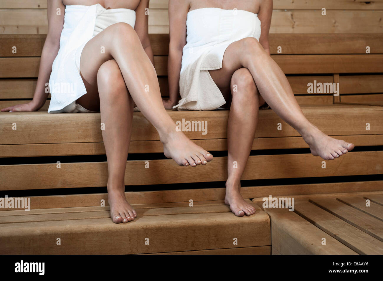 Two women in a sauna - Stock Image