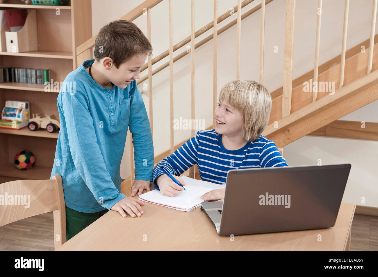 Two boys with homework - Stock Image