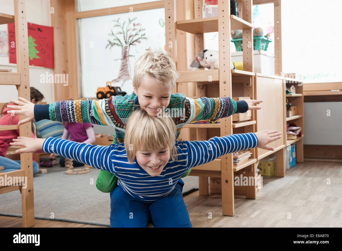 Two brothers playing together - Stock Image