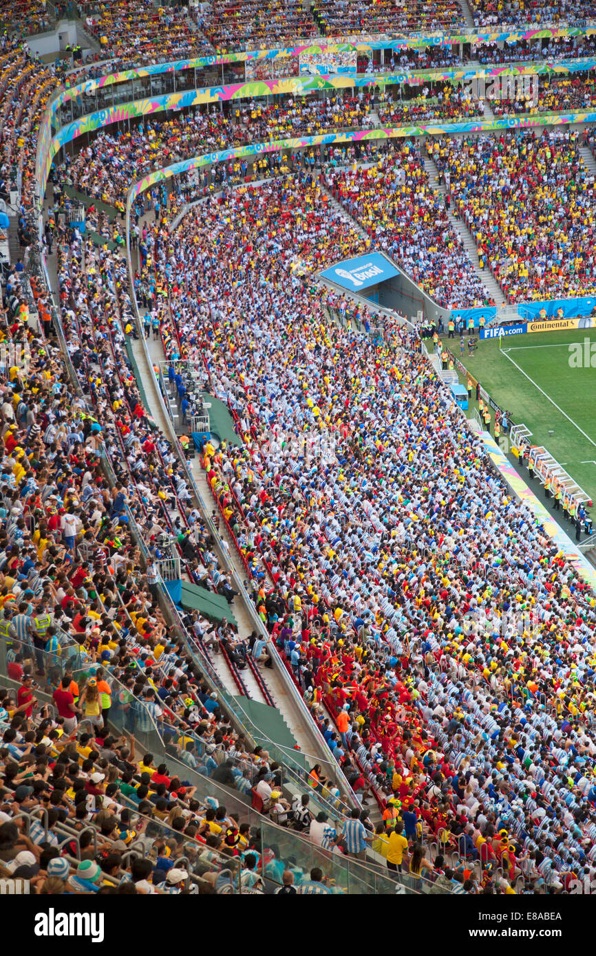 Football fans at World Cup match inside National Mane Garrincha Stadium, Brasilia, Federal District, Brazil - Stock Image