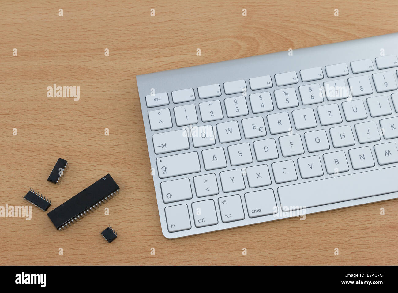 Metal Keyboard With White Keys And Four Computer Parts On Office Desk Stock Photo Alamy