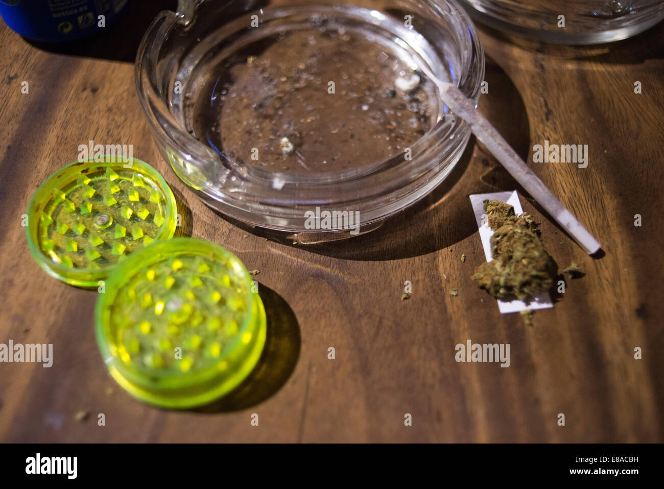 BARCELONA COFFEE SHOPS CANNABIS Marijuana In Barcelona.  Man's hands rolling marijuana joint inside the Kush - Stock Image